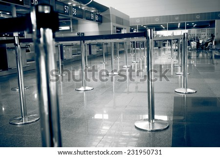Black and white photo of check-in line at airport - stock photo
