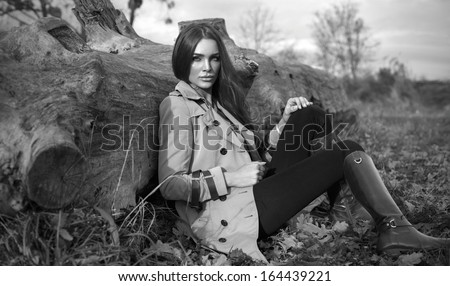 Black and white photo of fashion woman outdoor - stock photo