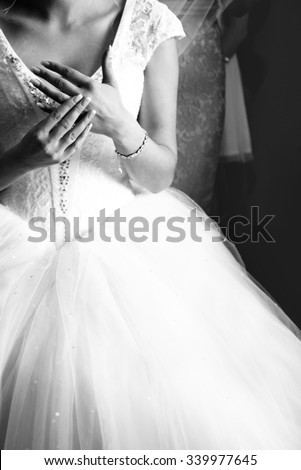 Black and white photo of gorgeous princess bride with wedding ring - stock photo