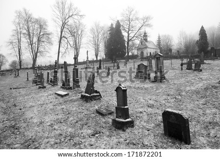 Black and white photo of graveyard in Czech republic - stock photo