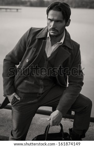 Black and white photo of handsome man - stock photo