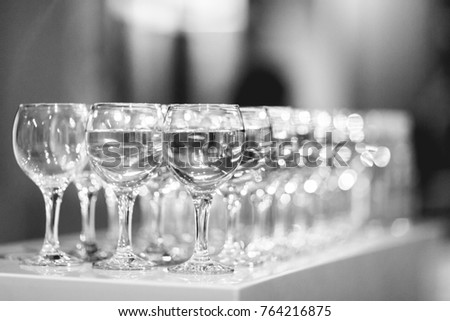 Black and white photo of lot of wine glasses