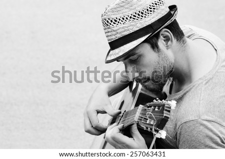 Black and white photo of man with the guitar. - stock photo
