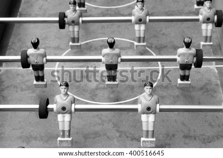Black and white photo of old table football - stock photo