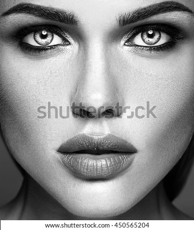 Black and white photo of sensual glamour beautiful woman model lady with fresh daily makeup and