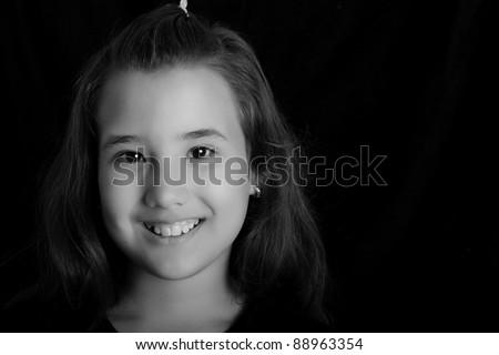 black and white photo of smiling child girl - stock photo