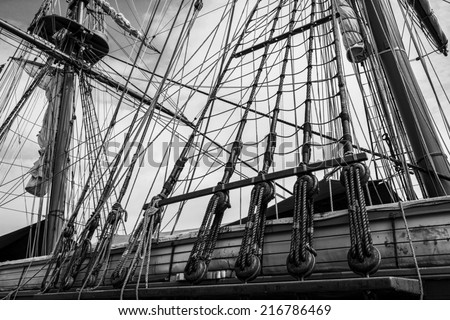 Black and white photo of the masts and rigging of the tall ship U.S. Brig Niagara. - stock photo