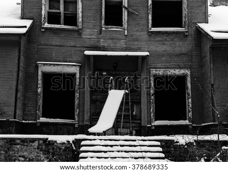 Black and white photo of the old dark wood house - stock photo
