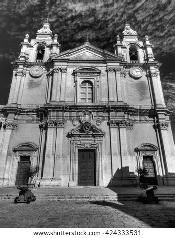 Black and white photo of the St. Peter & Paul Cathedral in the city of Mdina, in Malta - stock photo