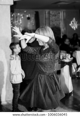 Black and white photo of women dancing in the club. December 26, 2017, Kiev, Ukraine.