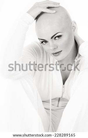 Black and white photo of young beautiful skinhead woman - stock photo