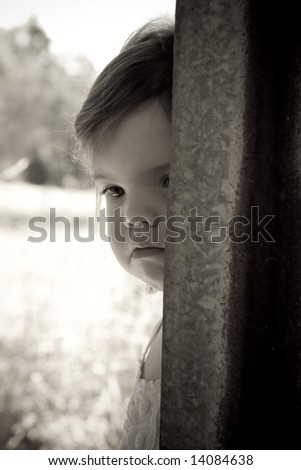 black and white photo of young toddler in the country