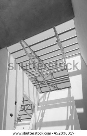 Black and white photo,Structure of steel roof frame for construction.