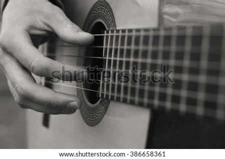 Black And White Photo The Young Man Playing An Acoustic Guitar Guitarist On