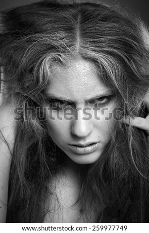black and white photograph of a dramatic portrait in studio - stock photo