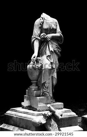 Black and White photograph of an antique female sculpture.