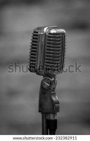 Black and white photograph of an early microphone from the 1940 era - stock photo