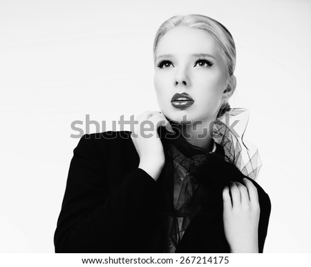 Black and white photography of a beautiful blonde fashion model in black jacket - stock photo
