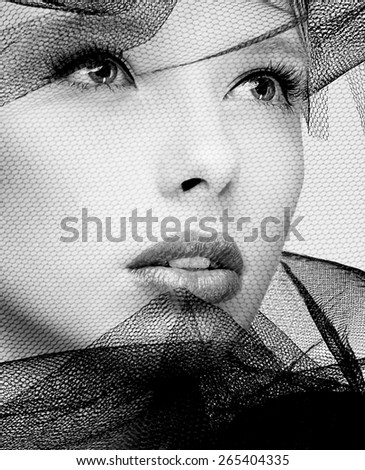 Black and white photography of a beautiful veiled fashion model face - stock photo