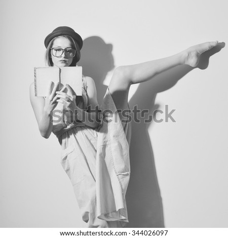 Black and white photography of beautiful young lady ballet dancer elegant female in a bowler