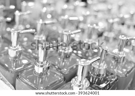 Black and white photography of bottles in row, close up  - stock photo