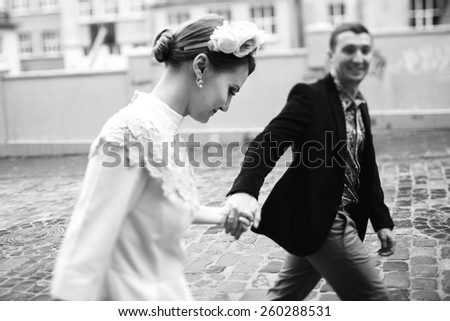 black and white photos of couples holding hands - stock photo