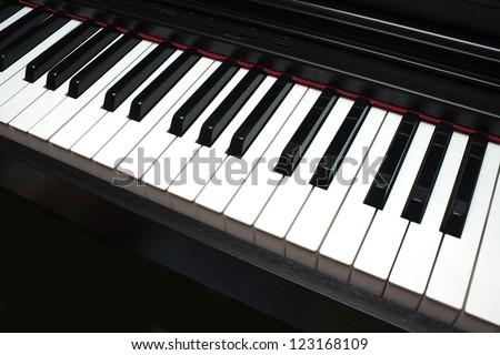 Black and white piano keys diagonal view - stock photo