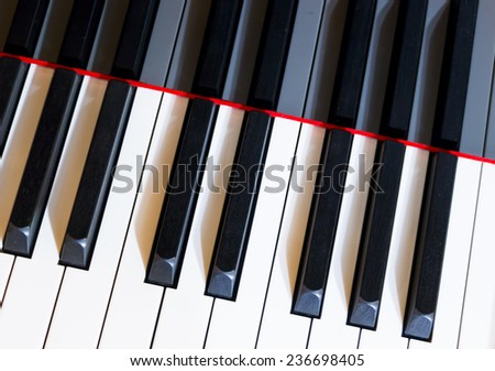 Black and white piano keys, keyboard of classical music instrument. - stock photo