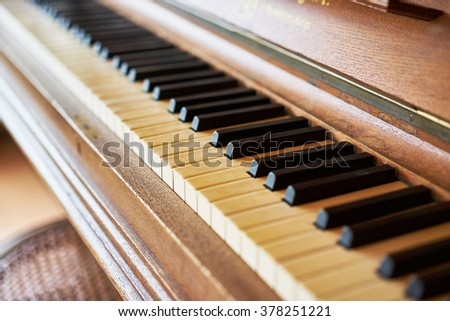 black and white piano keys on historical piano with ivory keys / beautiful keys of old piano / Black and White keys of piano - stock photo