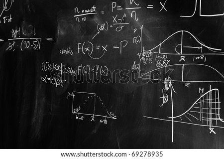 black and white picture of a chalkboard with formulas