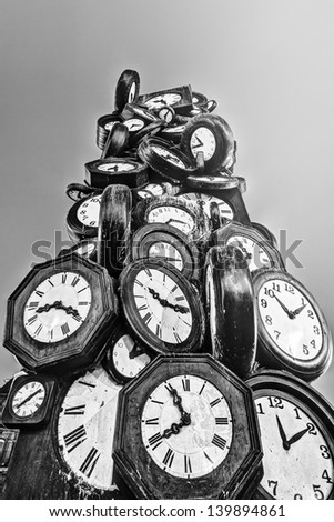 black and white picture of a tower of clocks situated at the station St. Lazare in Paris - stock photo
