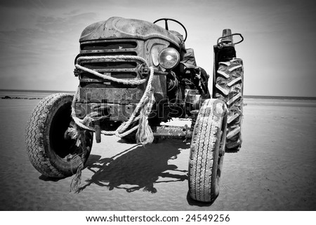 Black and white picture of an old rusty tractor.Vignetting