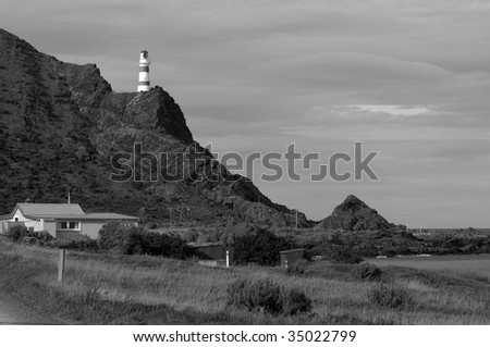 Black and white picture of Cape Palliser Lighthouse - North Island, New Zealand - stock photo