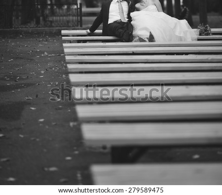 Black and white picture of happy wedding couple outside.  - stock photo