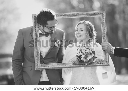 Black and white picture of happy wedding couple together. Groom and bride in frame. - stock photo