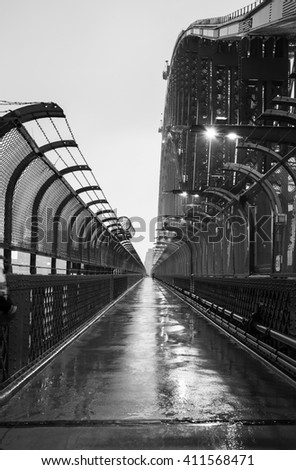 Black and white picture of Sydney Harbour Bridge in the rain - stock photo
