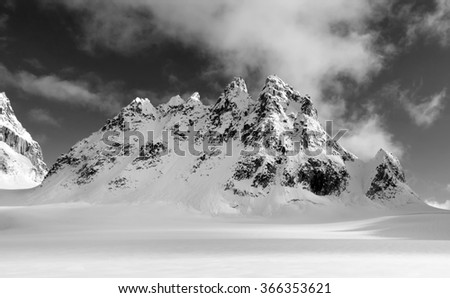 Black and White picture of the Trolls Rock Formation in the Alaska Mountain Range near Mount McKinley, Alaska - stock photo
