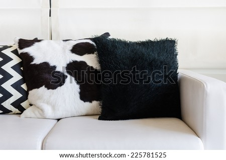 black and white pillows on white sofa in living room - stock photo