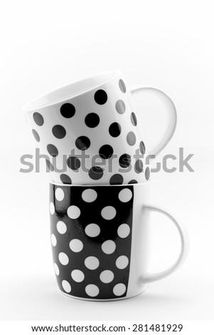 Black and white polka dots mugs isolated on white background - stock photo