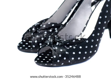black and white polka dots shoes isolated on white - stock photo