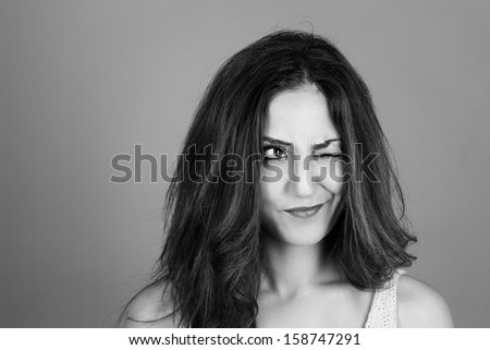 Black and white portrait of a beautiful brunette woman making faces