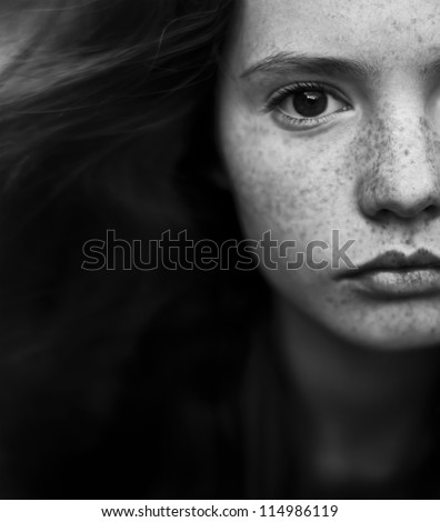 black and white portrait of a beautiful girl with freckles - stock photo