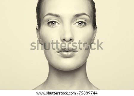 Black and white portrait of a beautiful young woman - stock photo