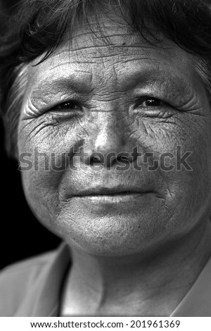 Black and white portrait of a Chinese old woman