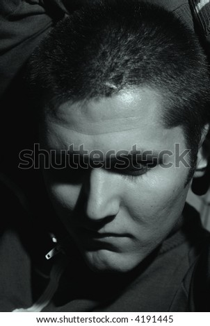 Black and white portrait of a depressed young man - stock photo