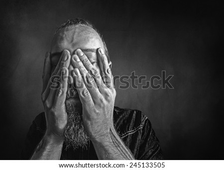 Black and white portrait of a desperate man. - stock photo