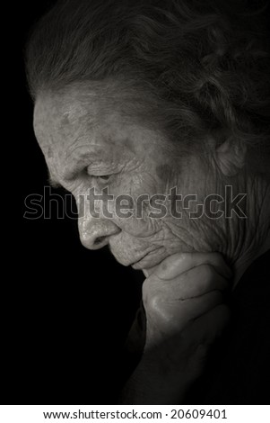 Black and white portrait of a elderly woman thinking.