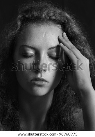 black and white portrait of a girl a woman with close eyes and curly hair - stock photo