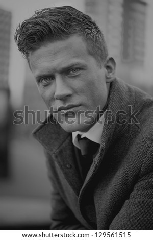 Black and white portrait of a handsome businessman outdoors - stock photo
