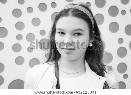 Black and white portrait of a happy teen girl